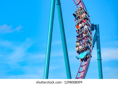 Orlando, Florida. December 26, 2018. People enjoy thrills for ride of the Mako roller coaster in amusement park at Seaworld in International Drive area.