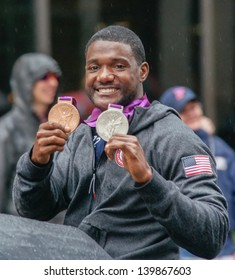 ORLANDO, FLORIDA- DECEMBER 29:  Olympic Gold medalist and track star Justin Gatlin displays his medals during the 2012 Orlando Citrus Parade in Orlando, Florida December 29, 2012.