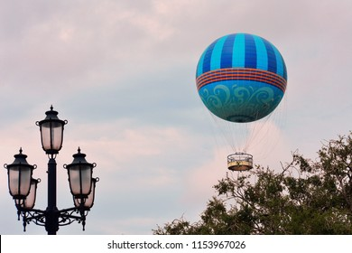 Orlando, Florida; July 27, 2018:  Beautiful sunset sky day with flying air balloon in Lake Buena Vista.
