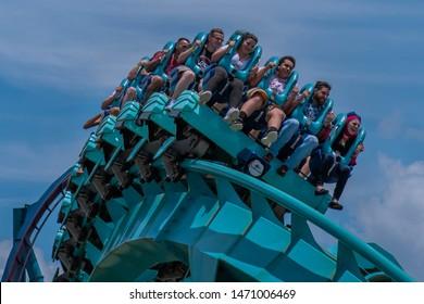 Orlando, Florida . July 31, 2019. People enjoying riding Kraken rollercoaster during summer vacation at Seaworld 13