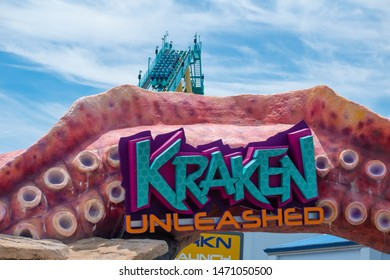 Orlando, Florida. July 31, 2019. Top view of colorful sign Kraken and rollercoaster at Seaworld 1.