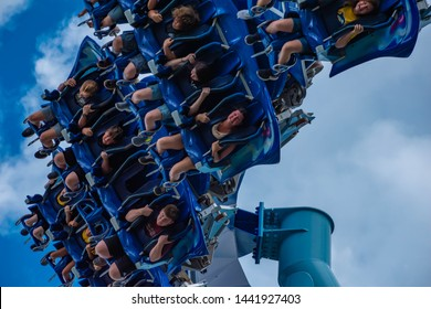 Orlando, Florida. June 17, 2019. Excited faces of people having fun Manta Ray rollercoaster at Seaworld 9