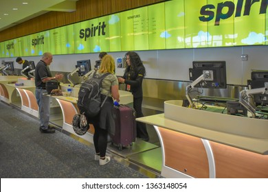 Orlando, Florida.  March 01, 2019. People doing check-in at Spirit Airlines counter in Orlando International Airport . (2)