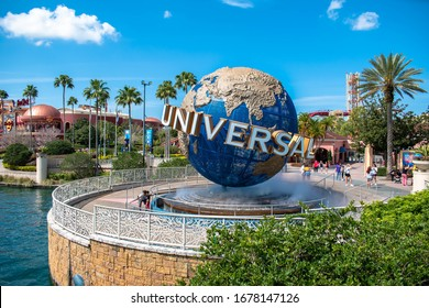 Orlando, Florida. March 15, 2020. Father and son taking photo next to world sphere at Universals Citywalk.