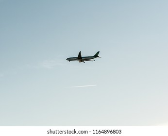 Orlando, Florida - March 17, 2018: Photo of an Aer Lingus commercial airline plane descending with its landing gear down.