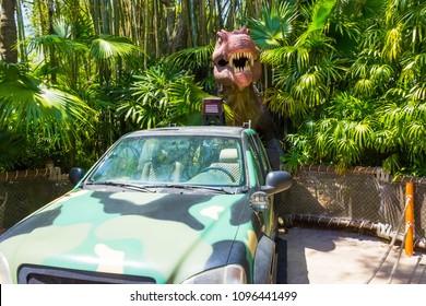 Orlando, Florida - May 09, 2018: Jurassic Park dinosaur and jeep at Universal Studios Islands of Adventure theme park in Orlando, Florida on May 09, 2018.
