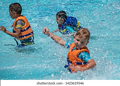 Orlando, Florida. May 20, 2019. Little boys playing with artificial waves in pool at Aquatica in International Drive area ENFOCADA 3 LUZ SUAVE