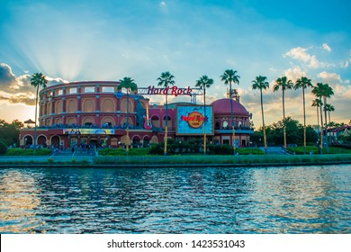 Orlando, Florida. May 22, 2019. Hard Rock Cafe on sunset background at Universal Orlando Resort in Florida with the lake on the foreground.  (1)