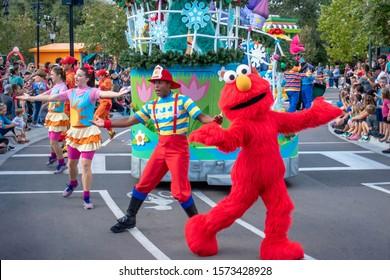 Orlando, Florida. November 22, 2019. Elmo and dancers in Sesame Steet Party Parade at Seaworld 2.