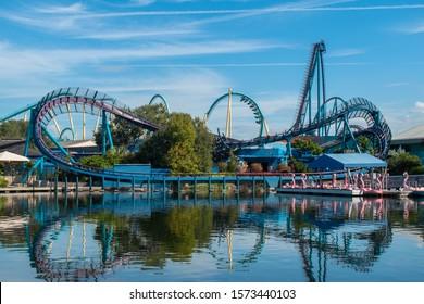Orlando, Florida . November 22, 2019. Panoramic view of Mako rollercoaster and paddle swan boats on lake at Seaworld 1