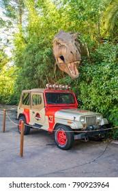 Orlando, Florida: November 30, 2017: Jurassic Park dinosaur and jeep at Universal Studios Islands of Adventure theme park in Orlando, Florida.