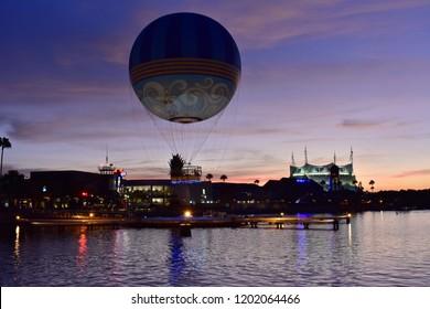 Orlando, Florida. October 11, 2018. Air balloon ascending and colorful dockside of Disney Springs  at Lake Buena Vista