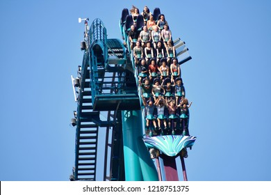Orlando, Florida. October 19, 2018 People of different ages thrilled and scared by fast descent riding Mako Roller Coaster at Seaworld Theme Park.