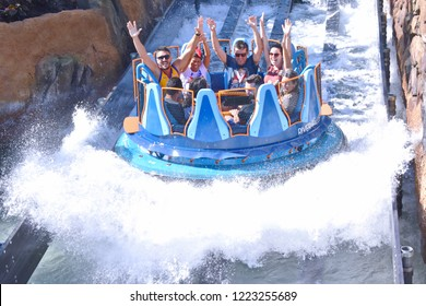 Orlando, Florida. October 19, 2018 Funny people raising hands, having fun Infinity Falls at Seaworld Theme Park.