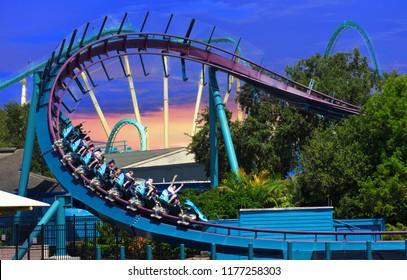 Orlando, Florida. September 09, 2018:  Amazing Mako roller coaster at Seaworld on beautiful sunset sky.