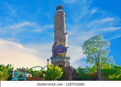 Orlando, Florida; September 21, 2018 Panoramic view of Adventure Island Lighthouse on cloudy blue sky, at Citywalk Universal Studios.