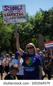 Orlando, Florida / USA - 03/25/2018 - March For Our Lives rally protest and demonstration protesters show their anti NRA signs in support of Gun Control