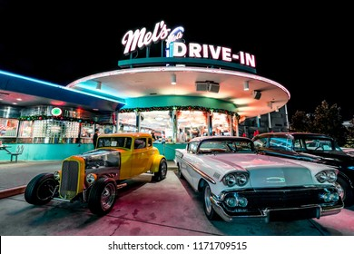 ORLANDO, FLORIDA, USA - DECEMBER, 2017: Beautiful Night at Mel's Drive-In restaurant with vintage classic cars at Universal Studios Florida