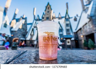 ORLANDO, FLORIDA, USA - DECEMBER, 2017: BUTTERBEER, drink from Harry Potter Movie containing 0% alcohol, at The Wizarding World of Harry Potter, Harry Potter Hogsmeade, Universal Studios