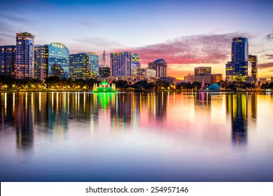 Orlando, Florida, USA downtown city skyline from Eola Park.