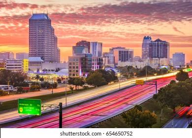 Orlando, Florida, USA downtown cityscape over the highway.