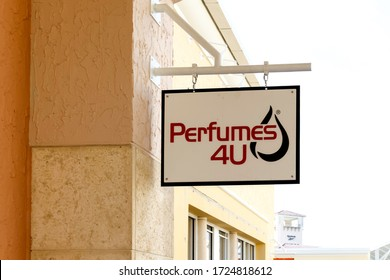 Orlando, Florida, USA - February 24, 2020: Perfumes 4U hanging sign outside of the store in  Orlando, Florida, USA.  Perfumes 4U is an American a family-owned and operated perfume retail company.