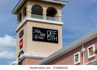Orlando, Florida, USA- February 24, 2020: Saks Fifth Avenue store sign on the building in Orlando, Florida, USA. Saks Fifth Avenue is an American luxury department store.