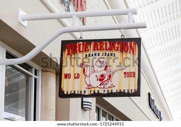 Orlando, Florida, USA- February 24, 2020: True Religion Brand Jeans hanging sign in Orlando, Florida, USA. True Religion Brand Jeans is an American clothing company.