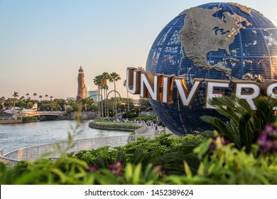 "Orlando, Florida, USA - July 27, 2019: The famous globe of planet Earth, icon on Universal Studios, the logo and the typography of the word ""Universal"", symbol of one of the city's major theme parks."