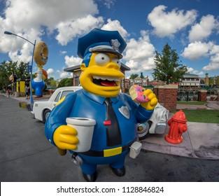 Orlando, Florida, USA - June 2015 : Universal Studios Theme Park, Chief Wiggum on the streets of Springfield