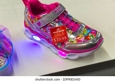 ORLANDO, FLORIDA, USA - MAY 08, 2018: Kids sketchers at outlet at Orlando Premium Outlet Shopping Mall, USA. Skechers is an American shoes company founded by CEO Robert Greenberg and his son Michael