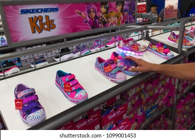 ORLANDO, FLORIDA, USA - MAY 08, 2018: Sketchers at outlet at Orlando Premium Outlet Shopping Mall, USA. Skechers is an American shoes company founded by CEO Robert Greenberg and his son Michael in