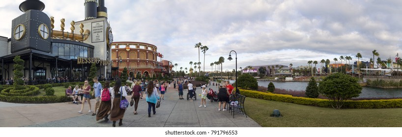 ORLANDO, FLORIDA, USA - NOVEMBER 3: People walk Universal City walk path at Universal Studios.  Taken November 3, 2017 in Florida.