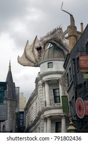 ORLANDO, FLORIDA, USA - NOVEMBER 3: Dragon on rooftop of Wizarding World Harry Potter Diagon Alley in Universal Studios.  Taken November 3, 2017 in Florida.