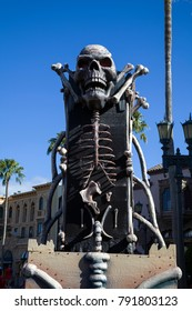 ORLANDO, FLORIDA, USA - NOVEMBER 3:Skeleton pedestal at Rodeo Drive Universal Studios .  Taken November 3, 2017 in Florida.