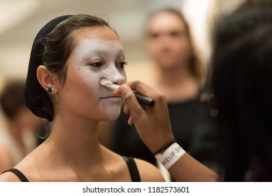Orlando, Florida / USA - September 15, 2018: Female Model Having White Colored Cosmetics Applied by a Makeup Artist at The Makeup Show in Orlando, FL