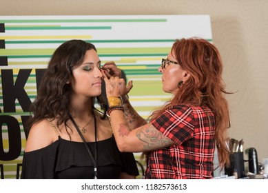 Orlando, Florida / USA - September 15, 2018: Makeup Artist Aga Kaskiewicz Delivering a Workshop with a Female Model at The Makeup Show in Orlando, FL