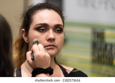 Orlando, Florida / USA - September 15, 2018: Female Model Having Cosmetics Applied by a Makeup Artist at The Makeup Show in Orlando, FL