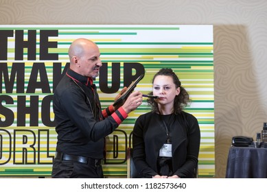 Orlando, Florida / USA - September 15, 2018: Makeup Artist Roque Cozzette Delivering a Workshop with a Female Model at The Makeup Show in Orlando, FL