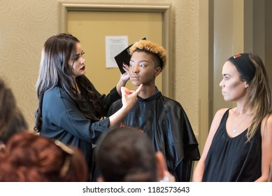 Orlando, Florida / USA - September 15, 2018: Makeup Artist Delivering a Workshop with Two Female Model at The Makeup Show in Orlando, FL