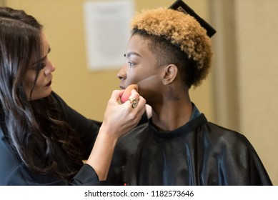 Orlando, Florida / USA - September 15, 2018: Makeup Artist Delivering a Workshop with a African American Female Model at The Makeup Show in Orlando, FL