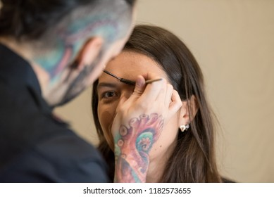 Orlando, Florida / USA - September 15, 2018: Female Model Having Her Eyebrows Brushed by a Makeup Artist at The Makeup Show in Orlando, FL