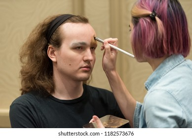 Orlando, Florida / USA - September 15, 2018: Male Model Having Cosmetics Applied by a Makeup Artist at The Makeup Show in Orlando, FL