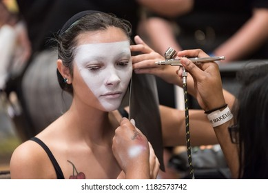 Orlando, Florida / USA - September 15, 2018: Female Model Having White Airbrushed Cosmetics Applied by a Makeup Artist at The Makeup Show in Orlando, FL