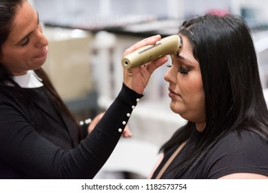 Orlando, Florida / USA - September 15, 2018: Woman Getting a Facial Message by a Skin Care Professional at The Makeup Show in Orlando, FL