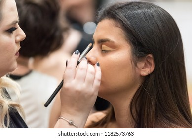 Orlando, Florida / USA - September 15, 2018: Female Model Having Eye Shadow  Cosmetics Applied by a Makeup Artist at The Makeup Show in Orlando, FL