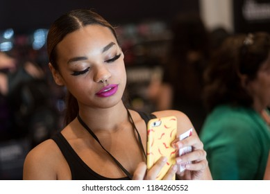 Orlando, Florida / USA - September 15, 2018: Beautiful Young Woman Taking a Selfie with Her Phone at The Makeup Show in Orlando, FL