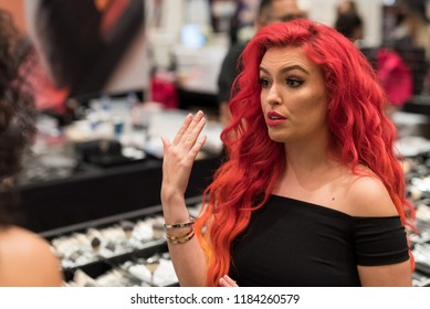 Orlando, Florida / USA - September 15, 2018: Attractive Woman with Red Hair at The Makeup Show in Orlando, FL