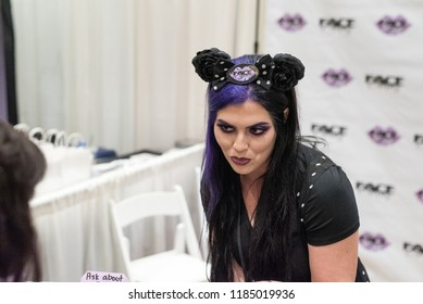 Orlando, Florida / USA - September 15, 2018: Face Candy Vendor Speaking to a Customer  at The Makeup Show in Orlando, FL