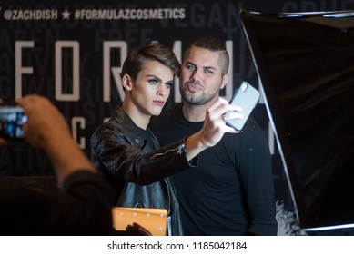 Orlando, Florida / USA - September 15, 2018: Zach Dishinger (left), Founder & CEO of Formula Z Cosmetics Taking a Selfie with a Friend in Front of a Soft Box at The Makeup Show in Orlando, FL